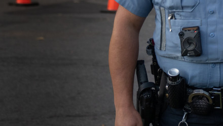 Photo of a police body camera on the uniform of a police officer