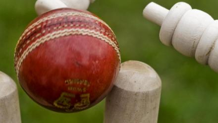 Cricket ball and stumps. Photo by Graham Dean on flickr.