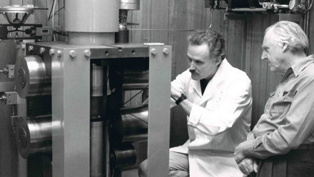 Professor Mervyn Paterson, right, looking at his invention the 'Paterson apparatus' which is still used today. Image courtesy ANU Research School of Earth Sciences.