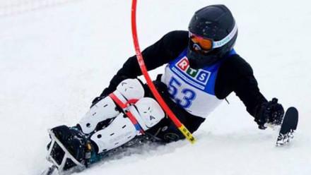 Paralympian Sam Tait using a sit-ski