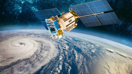 Space satellite orbiting earth from space