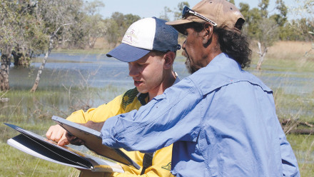 Fenner School Honours Student Rory Taylor and Yawuru Country Manager Pius Gregory examining a surface water map on Roebuck Plains Station in 2017