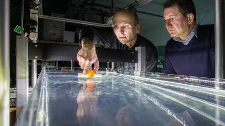 Dr Horst Punzmann (left) and Professor Michael Shats test their wave-generated tractor beam. Photo by Stuart Hay.