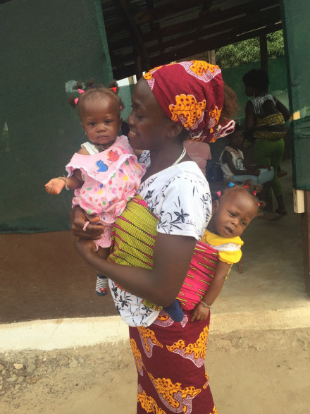 Sierra Leone mother carrying baby and toddler. Image provided by Dr Lokuge