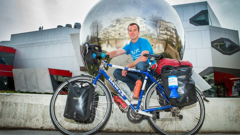 Chris Gruar at ANU near the end of his 45,000km ride from London to Sydney. Photo by Stuart Hay.