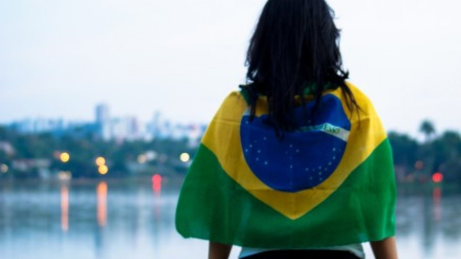 Photo of woman wrapped in Brazilian flag