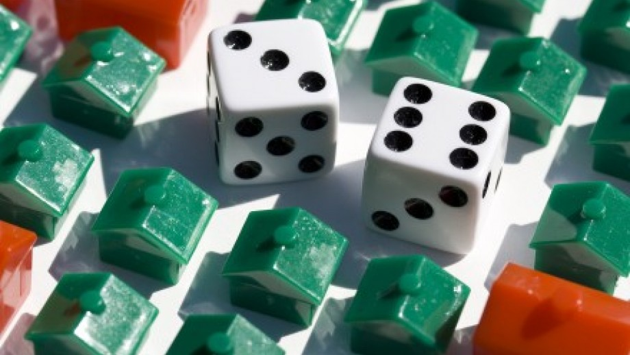 Picture of dice and Monopoly houses