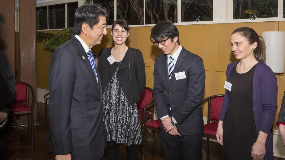 Japanese Prime Minister Shinzo Abe meets ANU students Sigourney  Irvine (L), Akira Kinefuchi and Catherine Hallett (R).