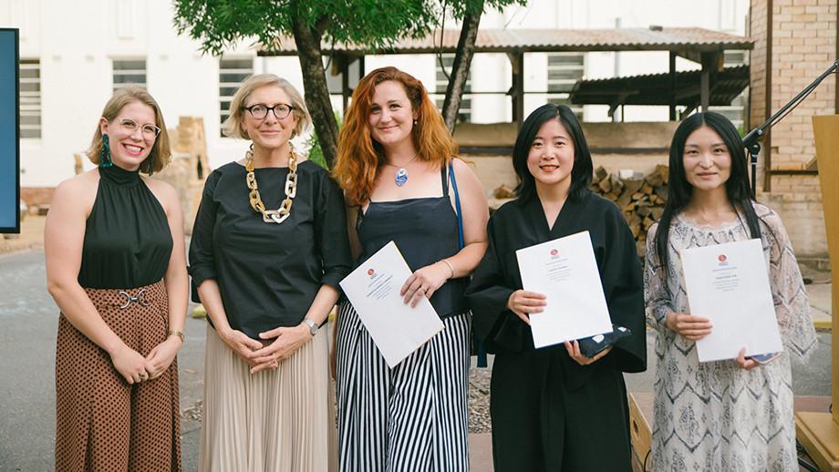 Katrina Leske (far left) presenting the Canberra Potters Society Group Exhibition Award to Henrietta Farrelly-Barnett (center), Cathy Zhang (center-right) and Yangyang Yin (far right). 2019. (Photo: Prue Hazelgrove Photography).