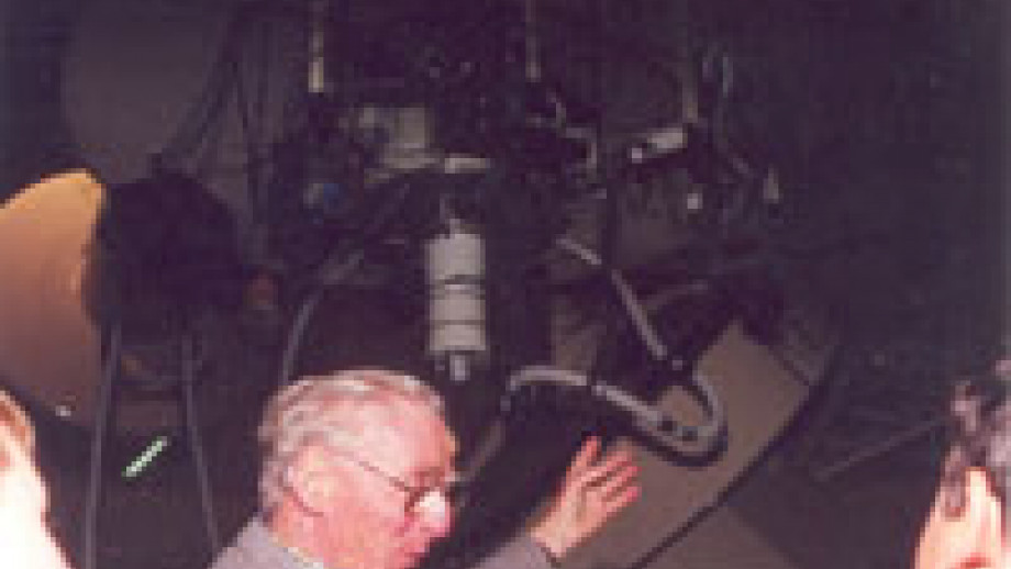 Hermann Wehner shows visitors through the Exploratory, 1990s (Mt Stromlo Archives)