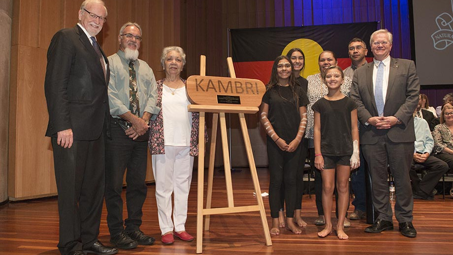 Elders present the name Kambri at the State of the University address. Photo by Lannon Harley.