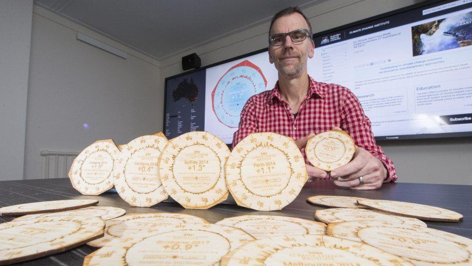 Dr Geoff Hinchcliffe shows off some of the climate coasters. Image: Lannon harley.