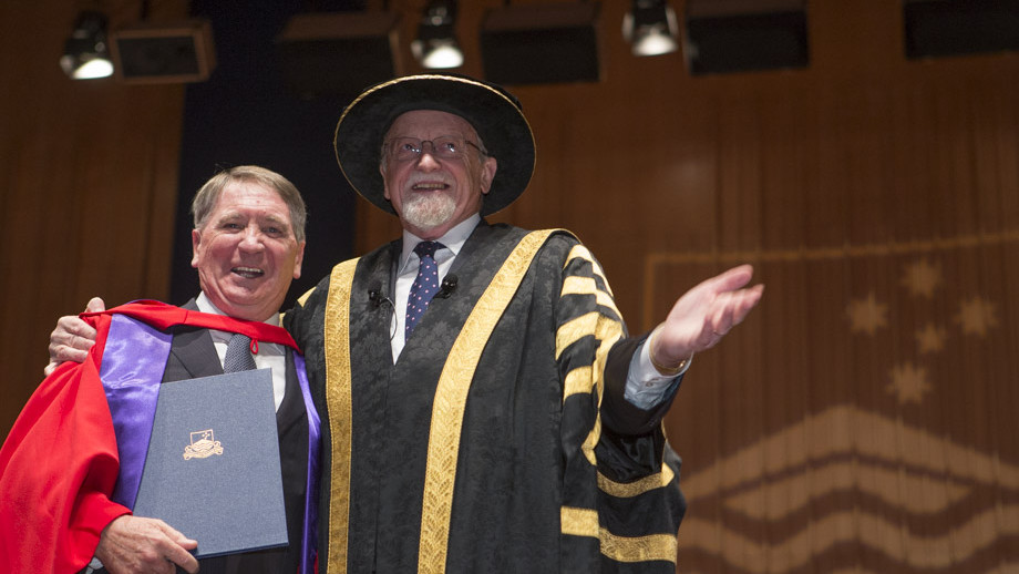 Dennis Richardson receiving his honorary degree from Chancellor Professor The Hon Gareth Evans. Photo by Lannon Harley, ANU.