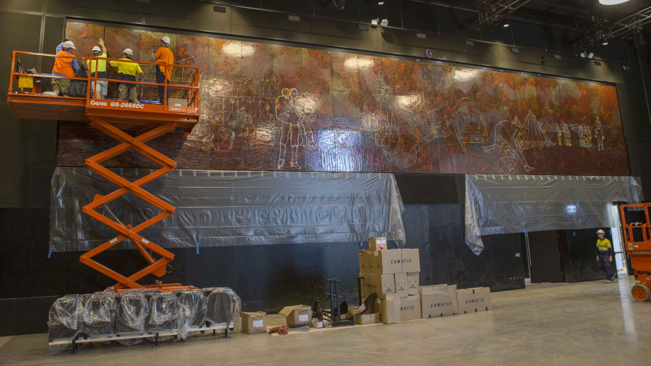 Staff from Abode Restoration and International Conservation Service install Sidney Nolan's Eureka Stockade in the Cultural Centre in the Kambri precinct. Photo: Lannon Harley, ANU