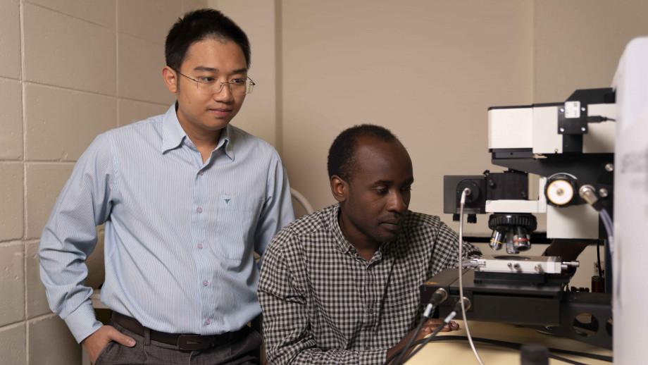 Dr Hieu Nguyen and PhD candidate Mike Tebyetekerwa. Image: Jack Fox, ANU