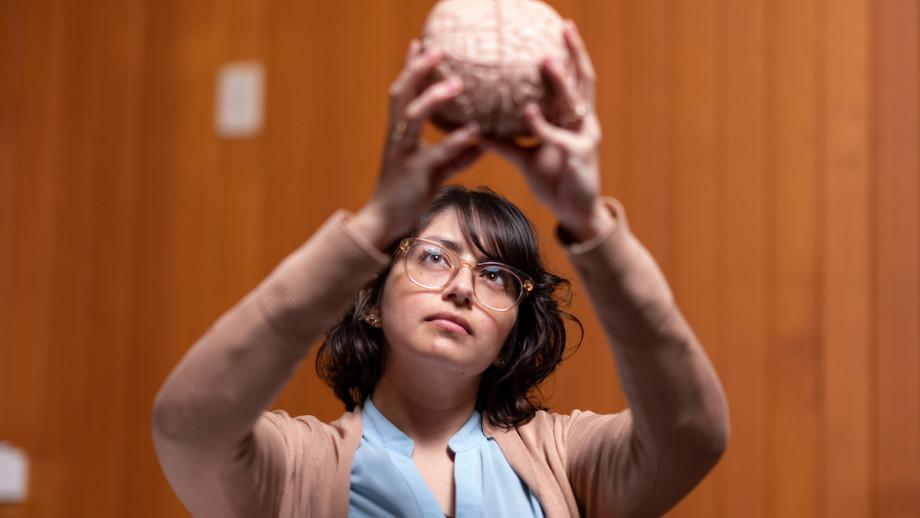 PhD researcher Ms Daniela EspinozaOyarce inspects a brain model