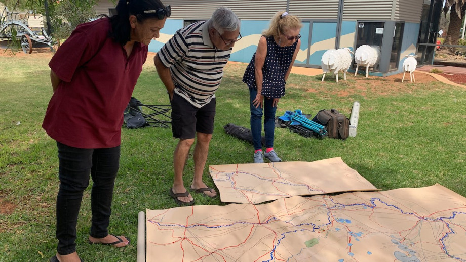 Coral Ellis, Daniel Kelly and Ann McGrath (left to right) viewing the map at Balranald, NSW.