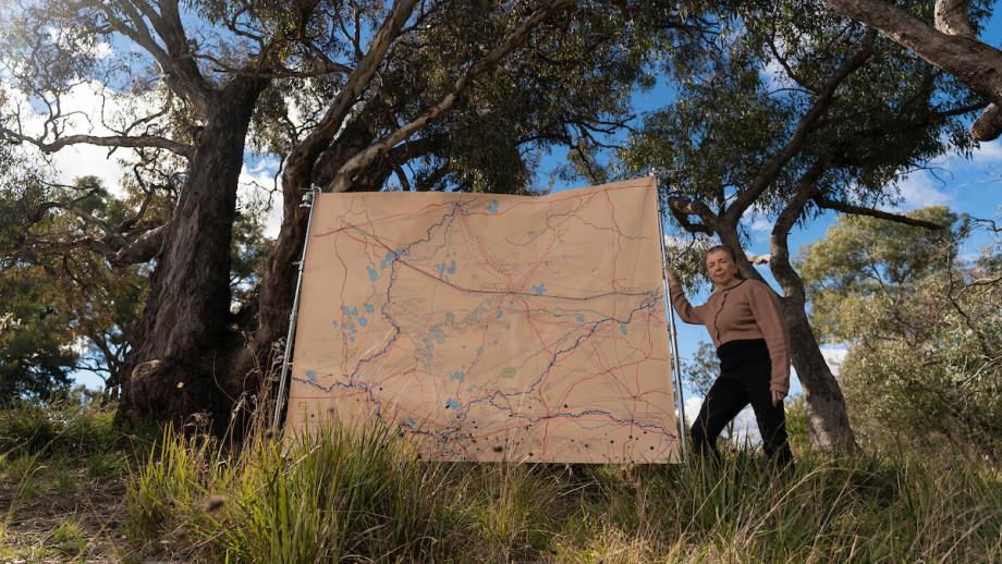 Professor Ann McGrath with the cultural map. Credit: Jamie Kidston, ANU