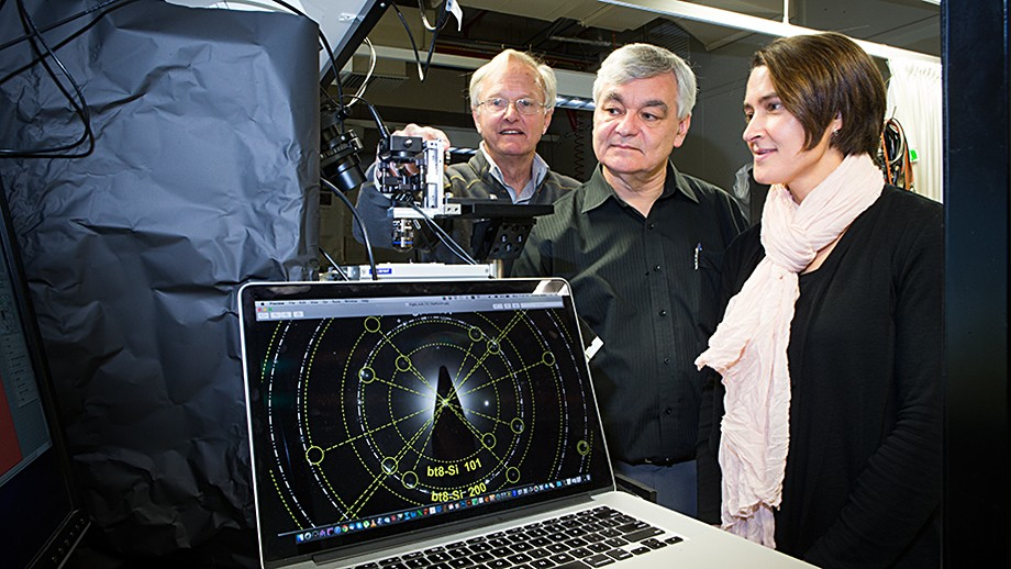 Professor Jim Williams (L), Professor Andrei Rode and Associate Professor Jodie Bradby with the electron diffraction pattern of one of their new silicon phases. Image: Stuart Hay, ANU