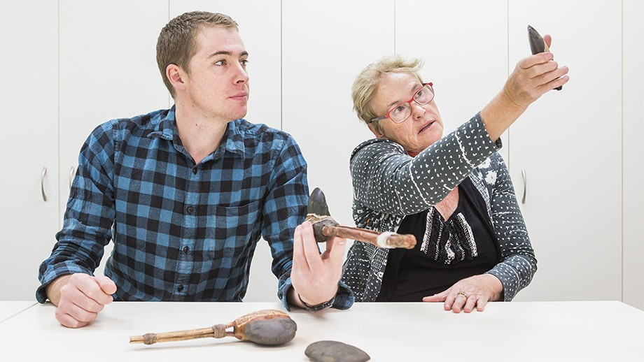 ANU researchers Professor Sue O'Connor and Tim Maloney examine examples of axes similar to the type that the fragments would have been from. Image: Stuart Hay, ANU.