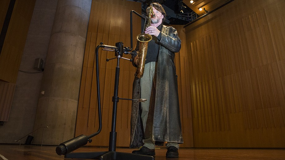 John Mackey with the prototype of the instrument stand that he and Stephen Holgate designed and created. Photo: Stuart Hay, ANU.
