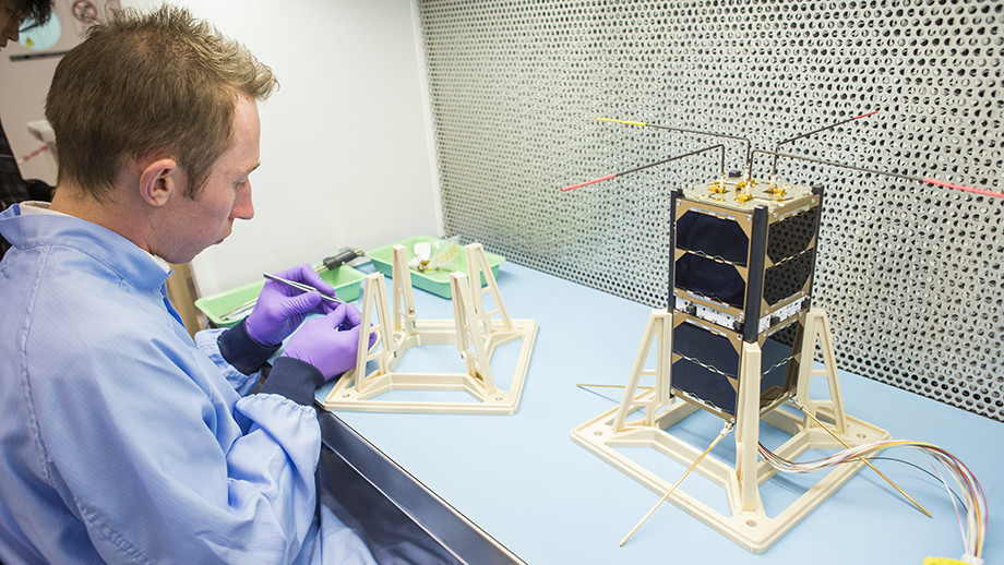 ANU engineer Bart Fordham with one of the Australian CubeSats
