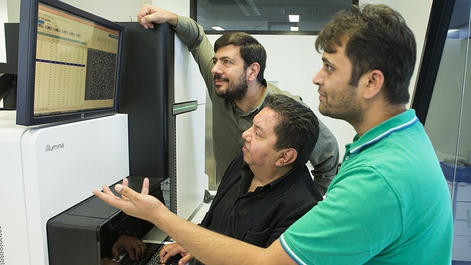 Associate Professor Arcos-Burgos (centre) with Dr Claudio Mastronardi and Dr Hardip Patel. Image Stuart Hay, ANU