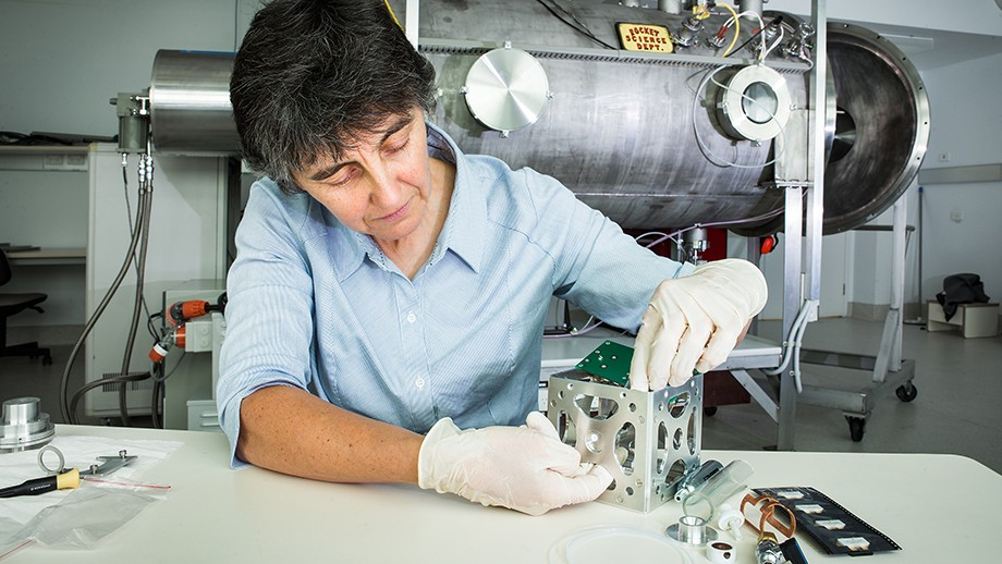 Professor Christine Charles works on a nanosatellite at the Research School of Physics and Engineering, Image Stuart Hay, ANU