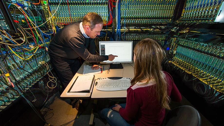 Professor Malcolm Sambridge with PhD student Jo Stephenson in the Terrawulf supercomputer. Image Stuart Hay, ANU