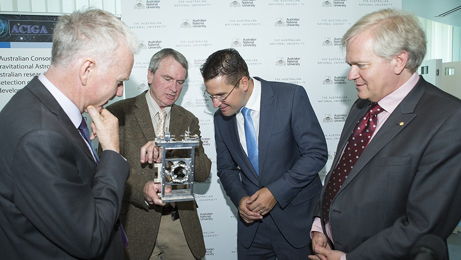 Left to Right: Prof Aidan Byrne (L), Prof David McClelland, Senator Zed Seselja and Prof Brian Schmidt, examining a mirror suspension system developed by ANU. Image Stuart Hay, ANU