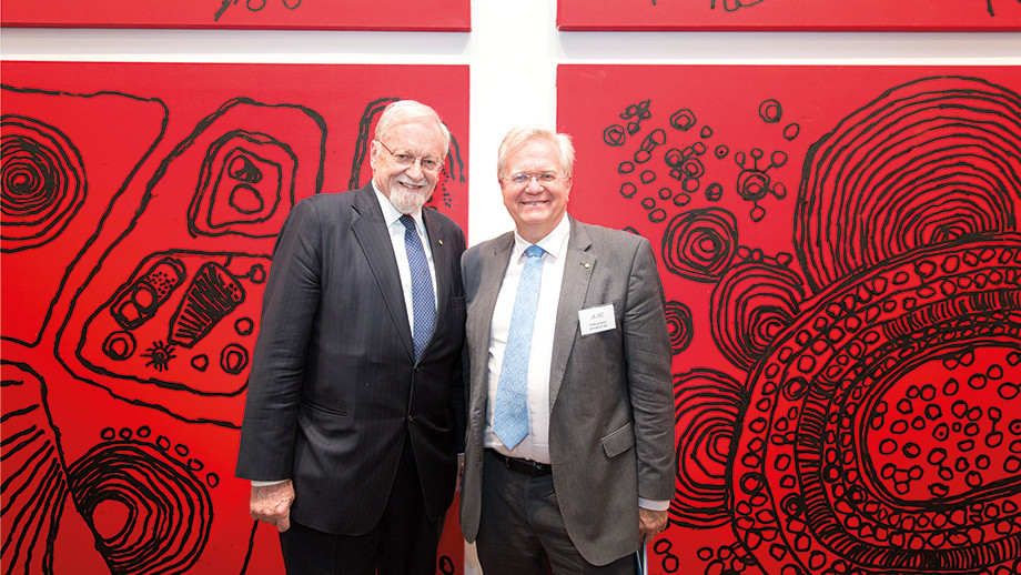 ANU Chancellor and Vice-Chancellor at the 2018 Celebration of Giving event in front of the 10 panels Iconography series by Naata Nungurrayi (c.1932-), 2011-2014