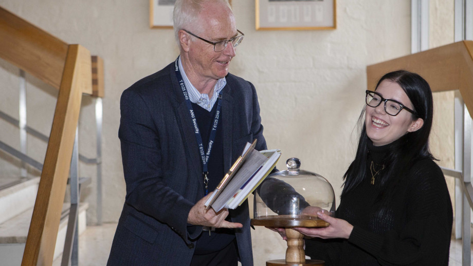 2019 Bake your PhD winner Boz Pasic receives her trophy, a cake stand, from Deputy Vice-Chancellor (Research & Innovation) Professor Keith Nugent. Photo by Lannon Harley, ANU.