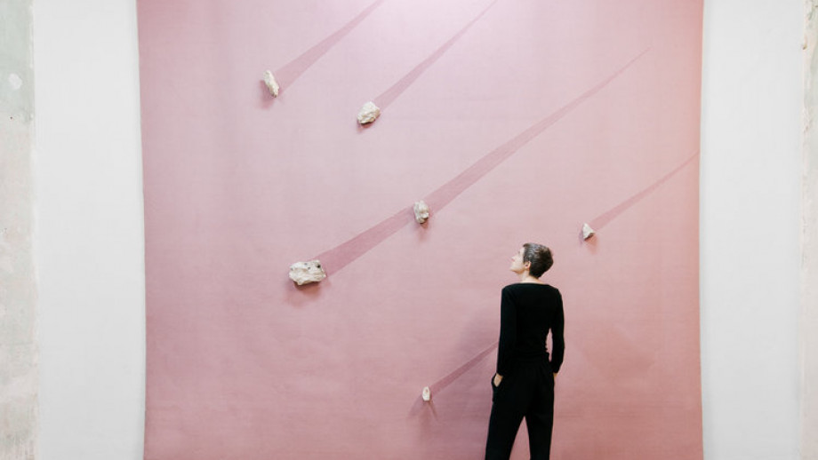 Catherine Evans with her work. Image via georgesmorafellowship.org.au