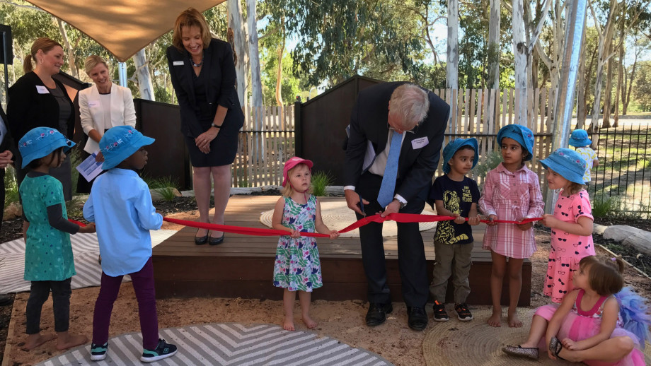 Vice-Chancellor Professor Brian Schmidt cutting the ribbon with children from the new ANU Goodstart Childcare Centre.