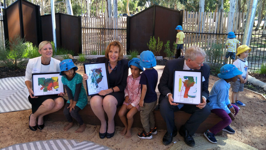 As part of the opening of the new ANU Goodstart Childcare Centre, the executive of Goodstart and ANU Vice-Chancellor Professor Brian Schmidt were presented with paintings from the children. Photo: Ivana Dulovic.