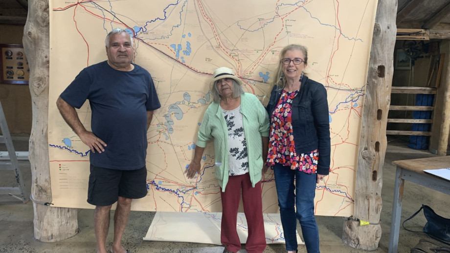 Danny and Mary Pappin with Ann McGrath (left to right) in front of the cultural map at the Australian Inland Botanic Gardens in Buronga, NSW.