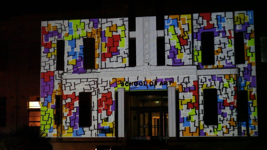 Staff and students at the ANU School of Art and Design are no strangers to projections on buildings. Here is one they have previously used on the facade of their building. Image: supplied.