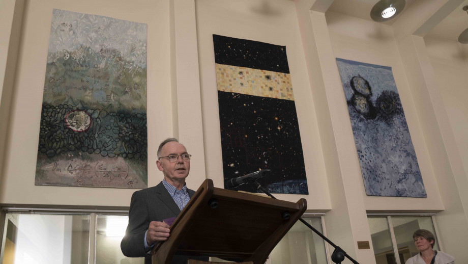 Professor Farquhar speaking at the tapestry unveiling. His tapestry, created by textiles artist Valerie Kirk, sits above his right shoulder, next to Vice-Chancellor Professor Brian Schmidt's, which was unveiled in 2013. Photos by Lannon Harley, ANU.