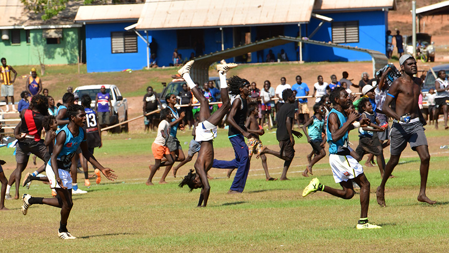 A game of football being played on country. Image: Wayne Quilliam