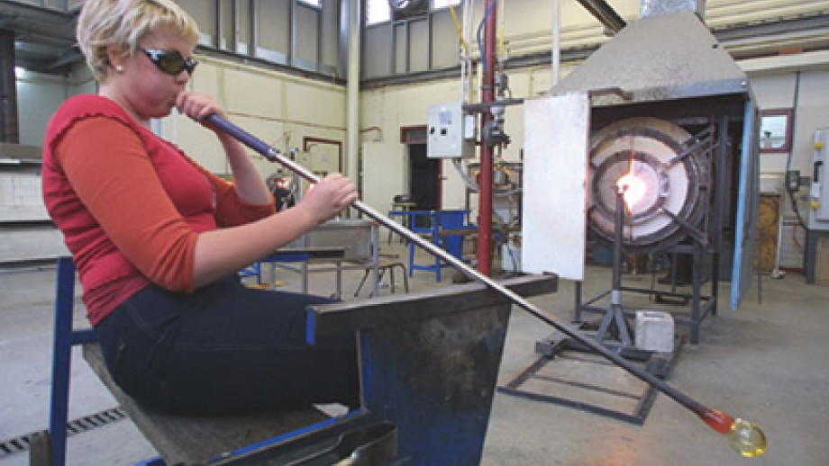 Woman glass blowing