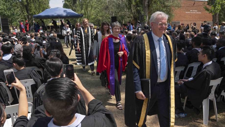 The Right Honourable Helen Clark ONZ SSI PC processing into the grounds of University Avenue behind ANU Vice-Chancellor Professor Brian Schmidt AAC FAA FRS. Photo by Lannon Harley, ANU.