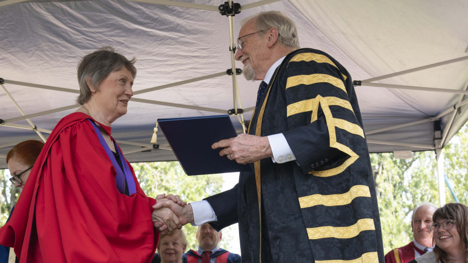 The Right Honourable Helen Clark ONZ SSI PC receiving her honorary degree from the ANU Chancellor Professor Gareth Evans AC QC. Photo by Lannon Harley, ANU.