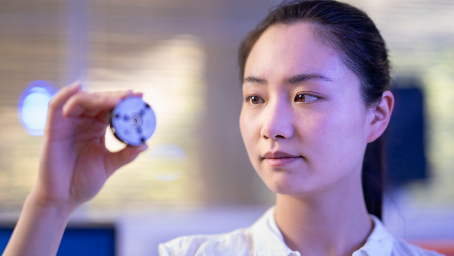 ANU PhD scholar Xingshuo Huang holds the diamond anvil that the team used to make the diamonds in the lab. Credit: Jamie Kidston, ANU