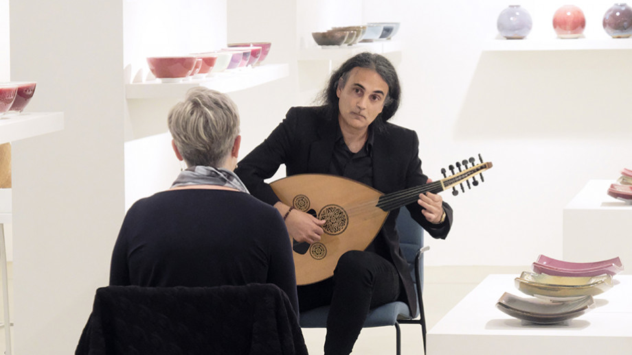 Head of ANU School of Music, Kim Cunio, playing the oud at Canberra Potters. Image: Peter Hislop