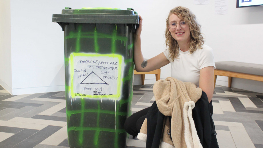 Lauren Dreyar with the green bin at the foyer of the ANU College of Law. Photo by Simon Jenkins, ANU.