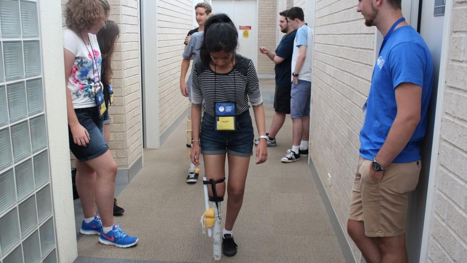 Year 12 student Sachini Perera tests a prototype prosthetic leg.
