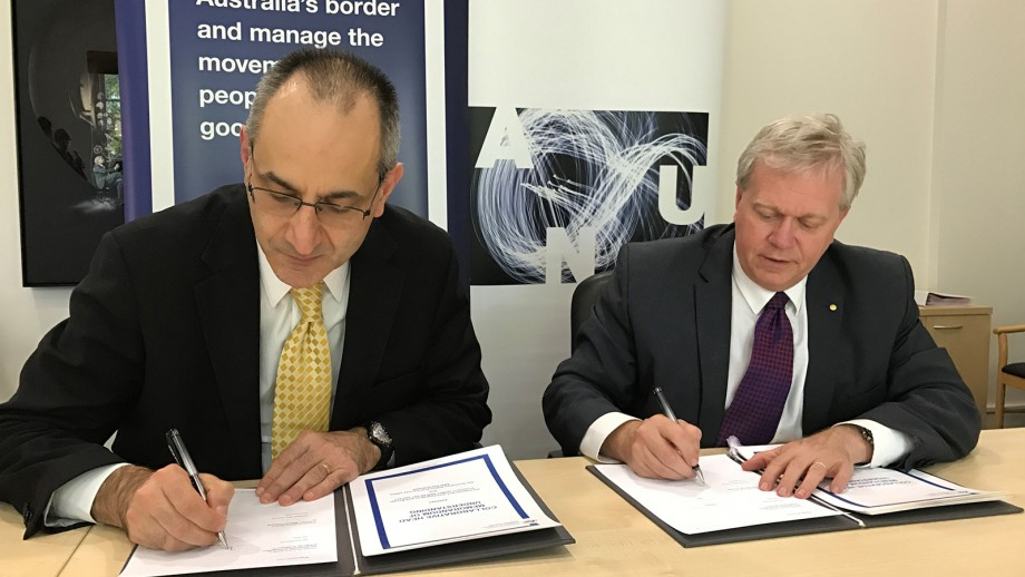 Michael Pezzullo, Secretary of the Department of Immigration and Border Protection, signs MOU with ANU Vice-Chancellor.