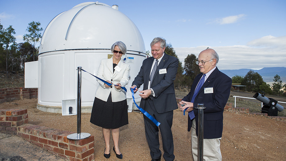 (L to R): Director-General of the ACT Education Directorate Natalie Howson, Professor Schmidt and Professor Ken Freeman cutting the ribbon to the new MSATT teaching telescope. Photo: Stuart Hay, ANU.