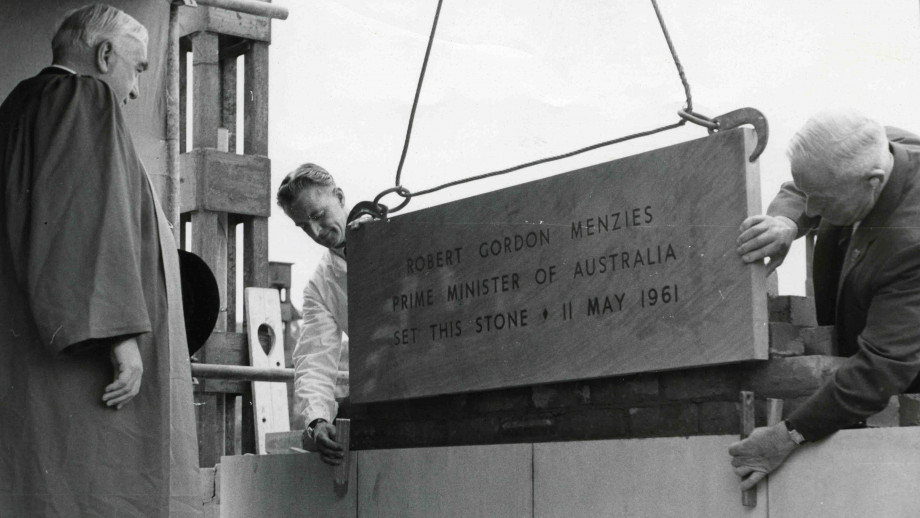 Former Australian Prime Minister Sir Robert Menzies overseeing the laying of the foundation stone for the Menzies Library in 1961. Photo: ANU Archives.