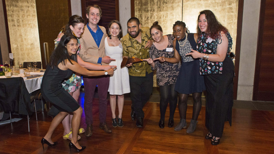 Young Alumnus of the Year, Omar Musa (centre) surrounded by current students and ANU alumni. Photo by Ricky Lloyd.